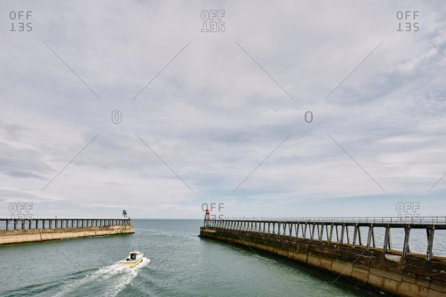 Whitby, North Yorkshire, England - July 21, 2017: Boat heading towards sea