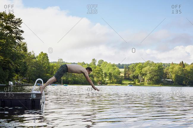 Mature man diving into lake