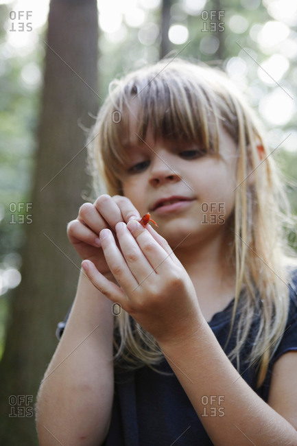 Young girl holding newt