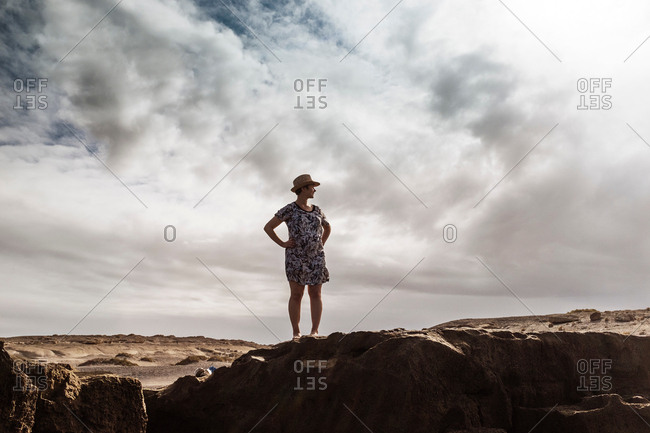 Woman standing on rocks, looking at view, Santa Cruz de Tenerife, Canary Islands, Spain, Europe