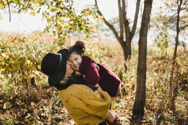 Mother kissing and hugging daughter, Oshawa, Canada, North America