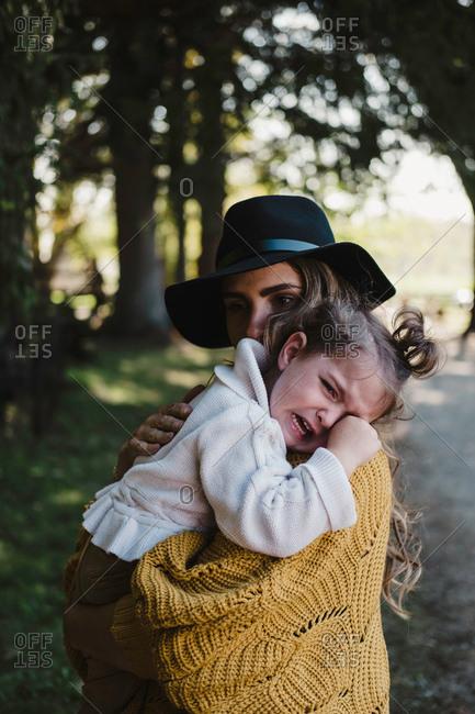 Mother comforting upset crying girl