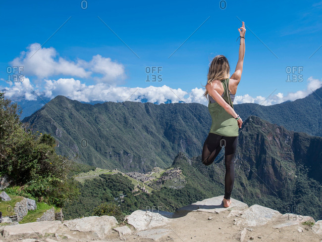 Rear view of woman practising yoga on the Inca Trail close to Machu Picchu, Cusco, Peru