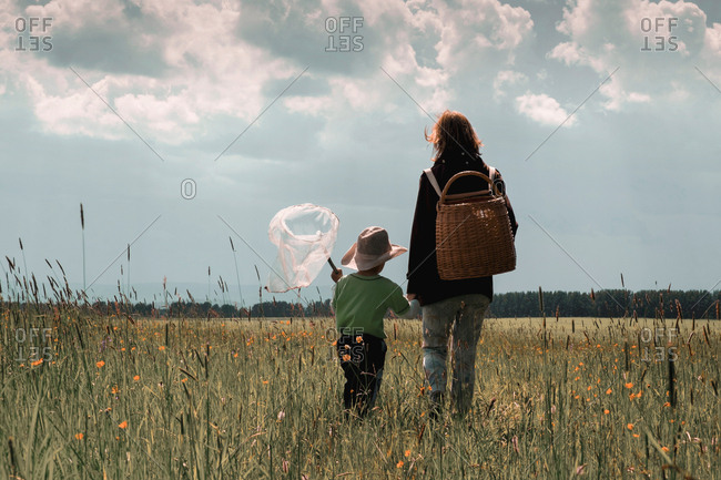 Mother and child with butterfly net, Ural, Sverdlovsk, Russia