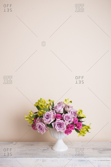Floral arrangement with roses and lilies