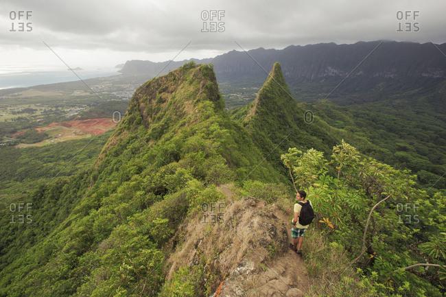 April 19, 2015: Hiker Looks At The Olomana Three Peaks Trail On The Hawaiian Island Of Oahu