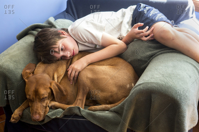 Boy Snuggles With His Dog