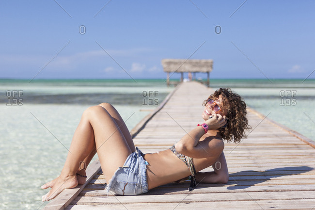 Tourist Girl Speaking At Her Smartphone On A Beautiful Beach In Cayo Guillermo, Cuba
