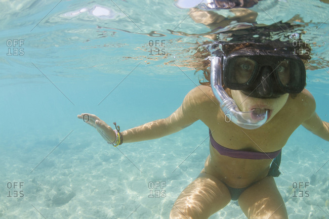 Underwater View Of A Girl Doing Snorkeling Using Snorkeling Mask In Cuba
