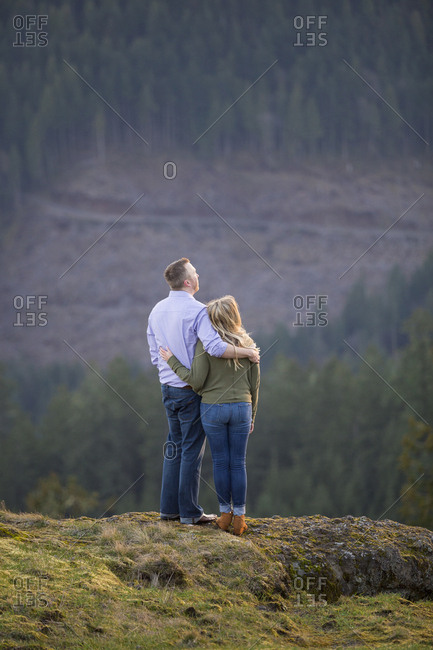Couple embracing in natural scenery while hiking at Horse Rock Ridge trail, Marcola, Oregon, USA