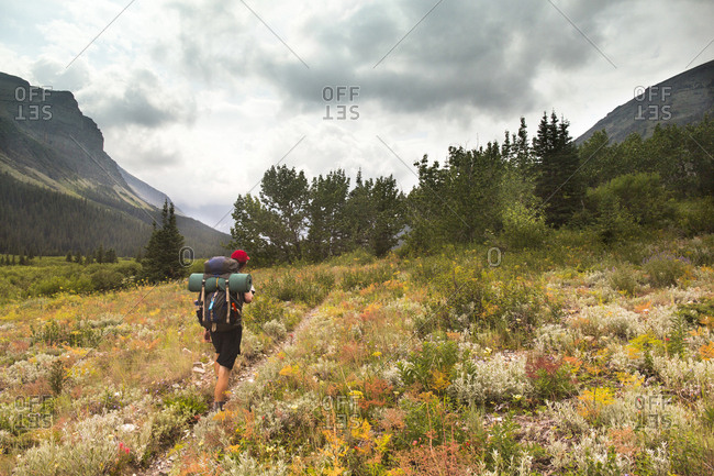 Person Hiking In Glacier National Park, Montana, Usa