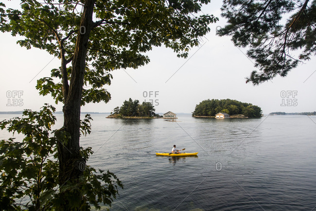 A Man Kayaking On Saint Lawrence River In The Thousand Islands Of Upstate New York