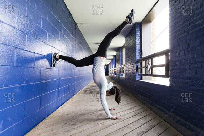 Woman Doing Exercise On The Corridor Of The Building
