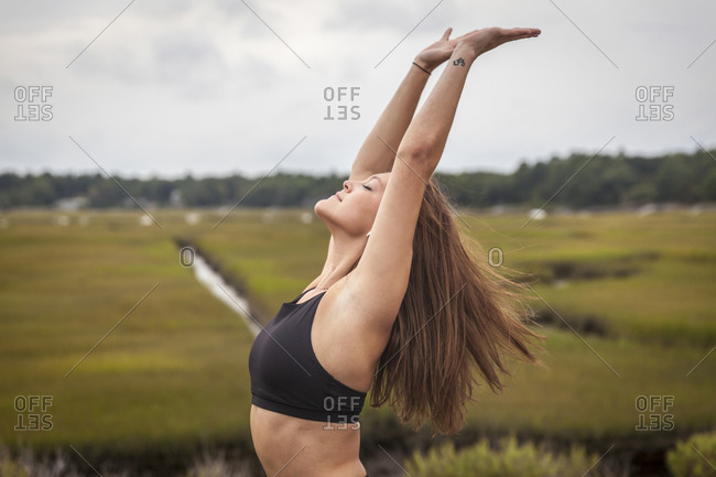 Woman Doing Yoga Leaning Back In A Backbend Outside On A Yoga Mat