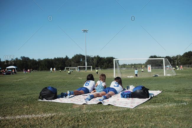 Girls watching soccer game