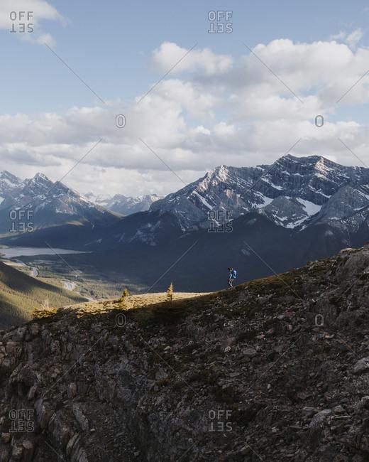 Man hiking on rocky mountainside