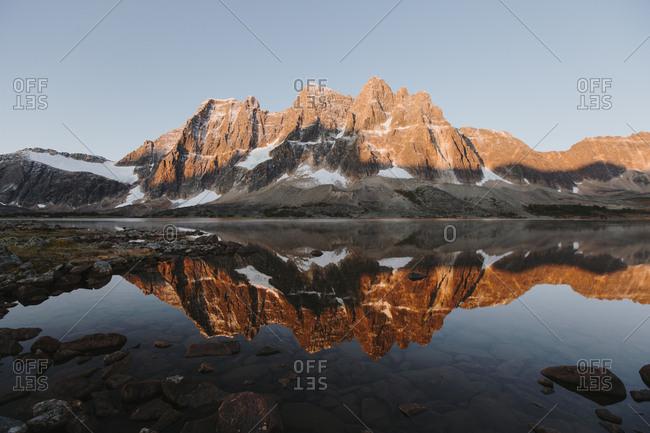 Majestic mountain landscape with lake at sunrise