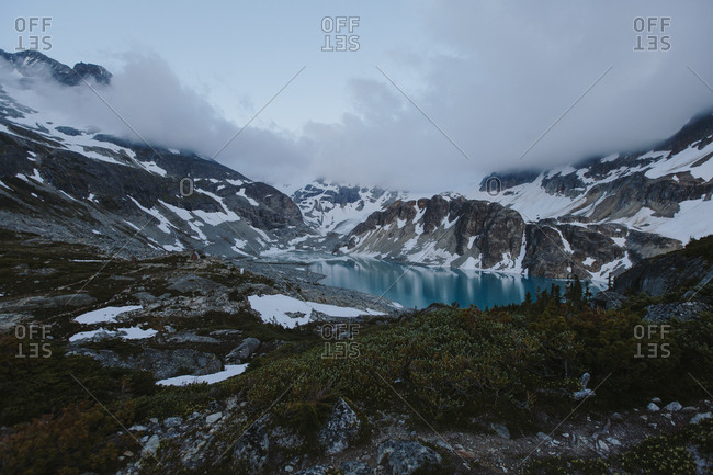 Snowy mountains and blue lake in Whistler, British Columbia, Canada