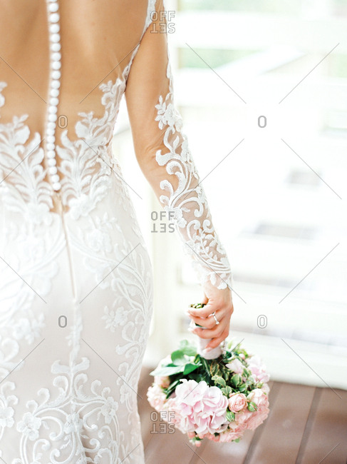 Bride walking away holding bridal bouquet