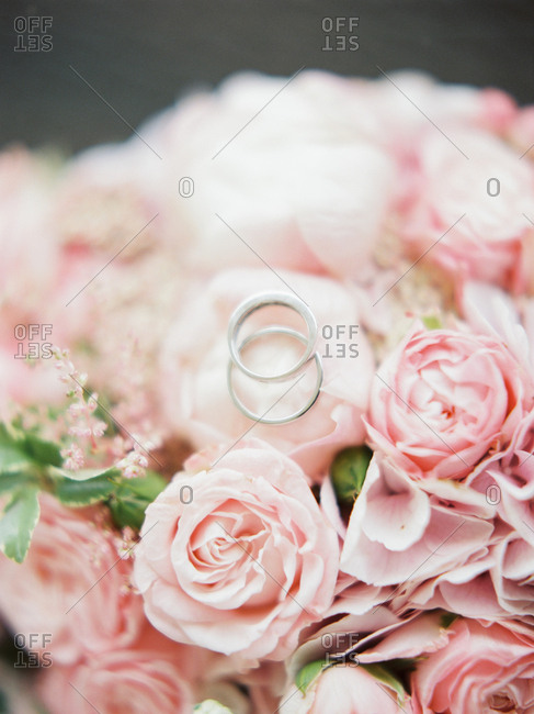 Wedding rings on top of bridal bouquet