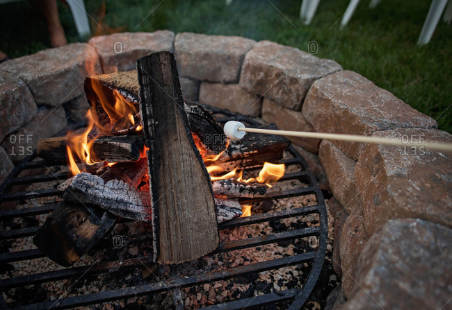 Marshmallows being roasted over a campfire
