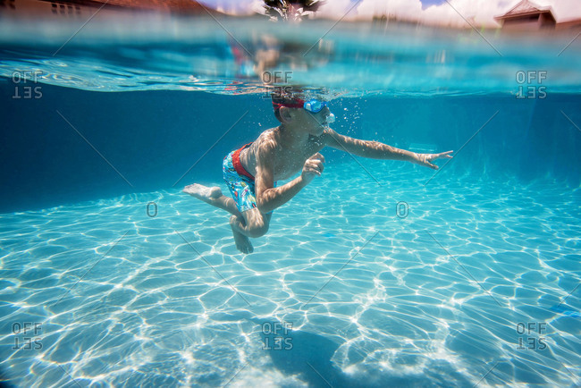 Underwater view of boy in a swimming pool
