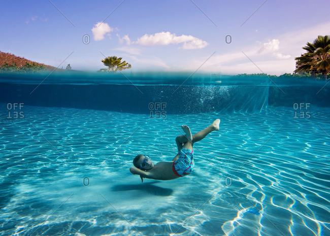 Underwater view of boy swimming in a pool