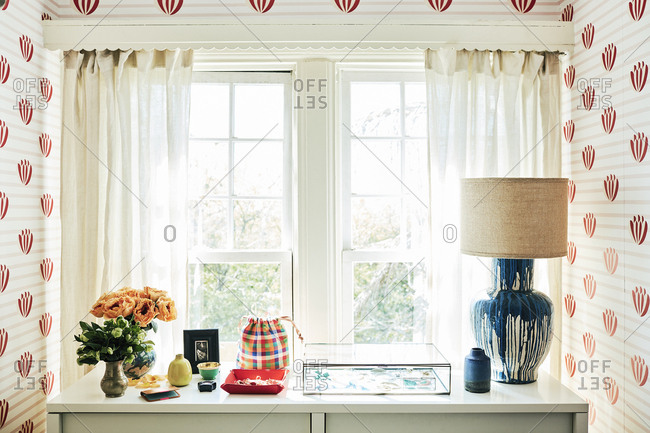 Los Angeles, California, USA - October 5, 2017: Interior of house with lamp, flower vases, and other items on dresser