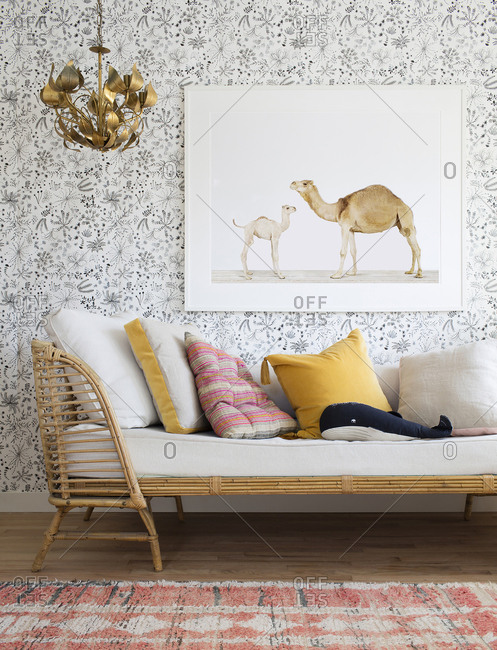 Los Angeles, California, USA - November 9, 2017: Interior of baby nursery with couch, artwork, and hanging lamp