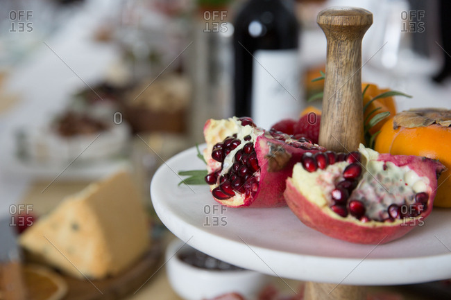 Pomegranate on an appetizer stand