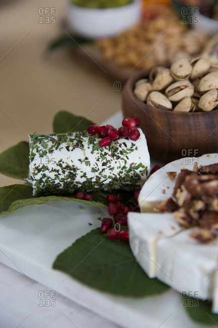 Cheese platter with pomegranate and nuts