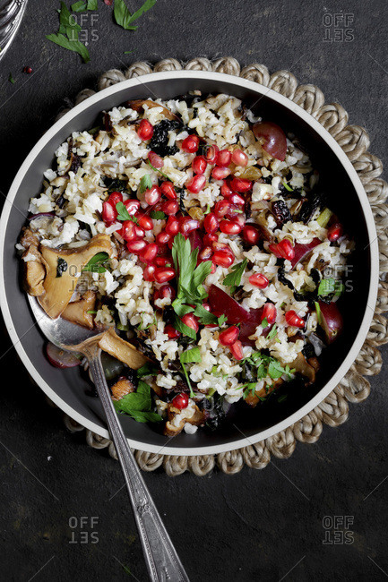 Rice, pomegranate seeds and mushrooms savory side