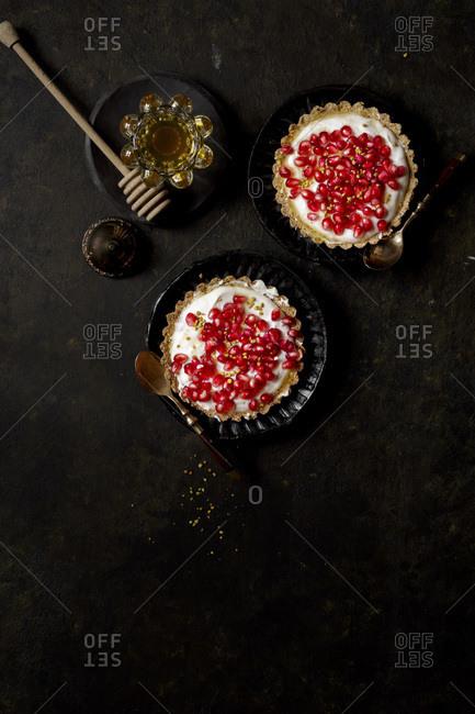 Yogurt Honey Tart covered in fresh pomegranate seeds