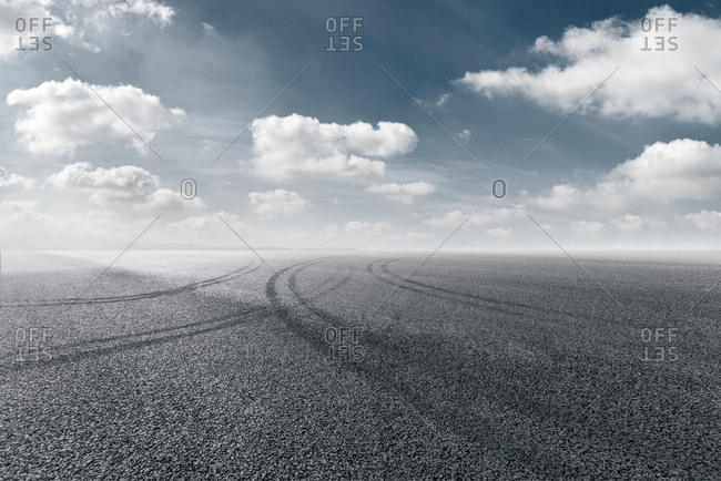 Tire tracks on empty road