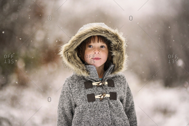 Young girl bundled in a fur coat