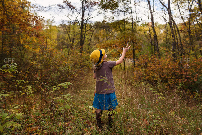Young girl playing in a field