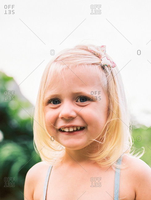 Portrait of a little girl with a bow in her hair