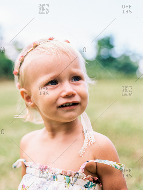 Portrait of a toddler girl looking away