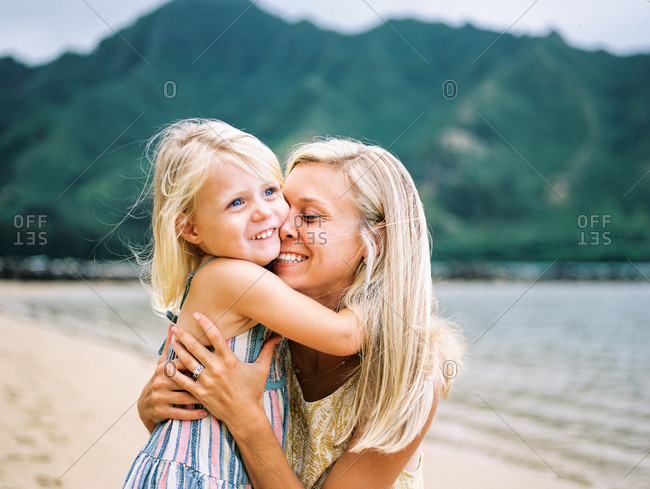 Mother hugging her daughter - Offset