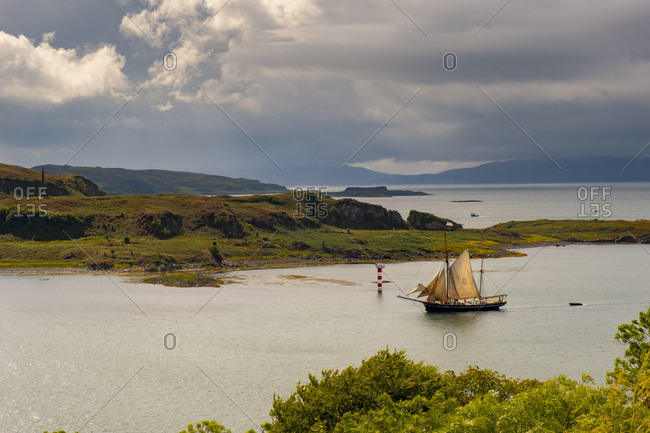 Scottish Highlands, Scotland - August 17, 2017: Ship sailing into harbor off the coast of Scotland