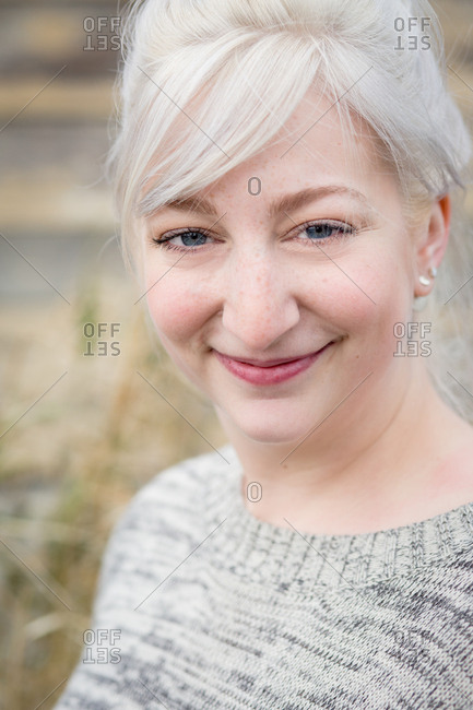 Close up of woman with platinum blonde hair