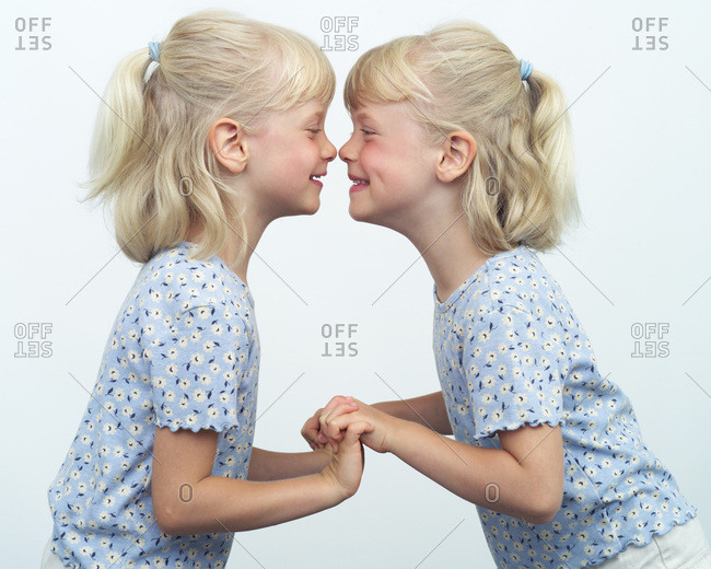Twins Giggling Together