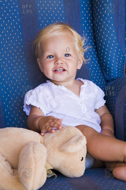 Toddler with Teddy Bear in Armchair