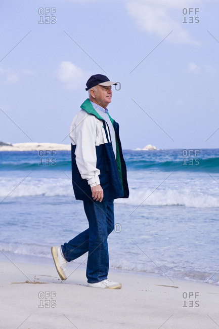 Man Walking on the Beach