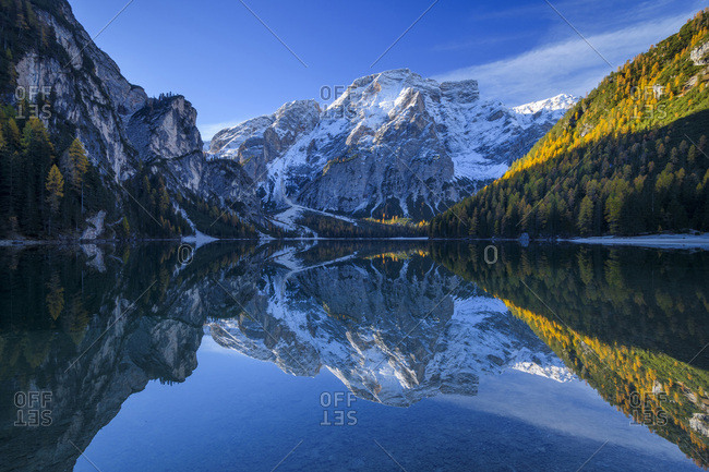 Croda del Becco (Seekofel) reflected in the calm waters of Braies Lake in autumn in the Prags Dolomites, South Tyrol, Italy