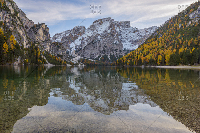 Croda del Becco (Seekofel) reflected in the still waters of Braies Lake in autumn in the Prags Dolomites, South Tyrol, Italy