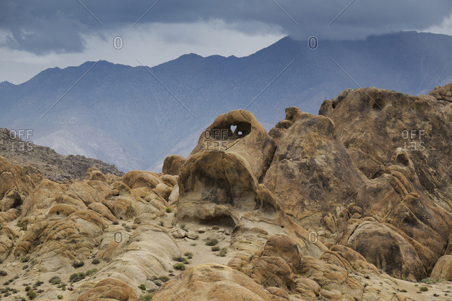 Rock formations of the Alabama Hills with the Sierra Nevada Mountains in the background in Eastern California, USA
