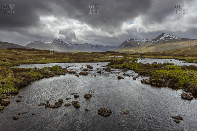 Moor landscape with river and storm clouds at Rannoch Moor in Scotland, United Kingdom