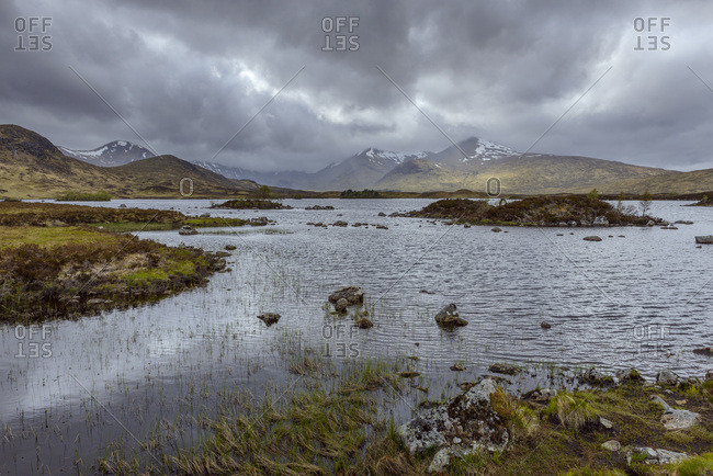 Moor landscape with a river and storm clouds at Rannoch Moor in Scotland, United Kingdom