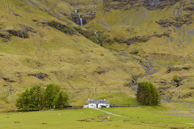 Isolated home in the highlands at Glen Coe in Scotland, United Kingdom
